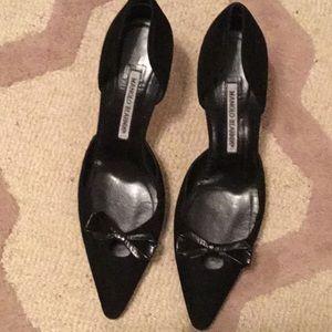 MAnolo Blahnik suede bow tie heels.